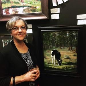 Carol Landry & cow painting, Idyllwild show•